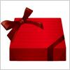 赤いリボンでラッピングされたプレゼントギフトボックス