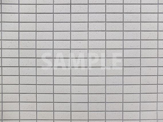 綺麗に整列した白いタイル壁