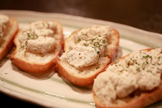フランスパンのディップの写真・フォト素材